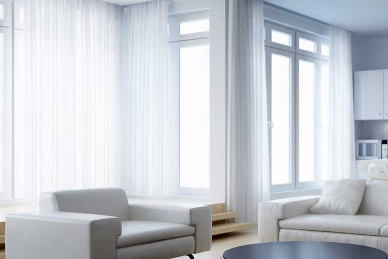 Modern interior living room with white sofa set and white curtains, What Color Curtains Make a Room Look Bigger