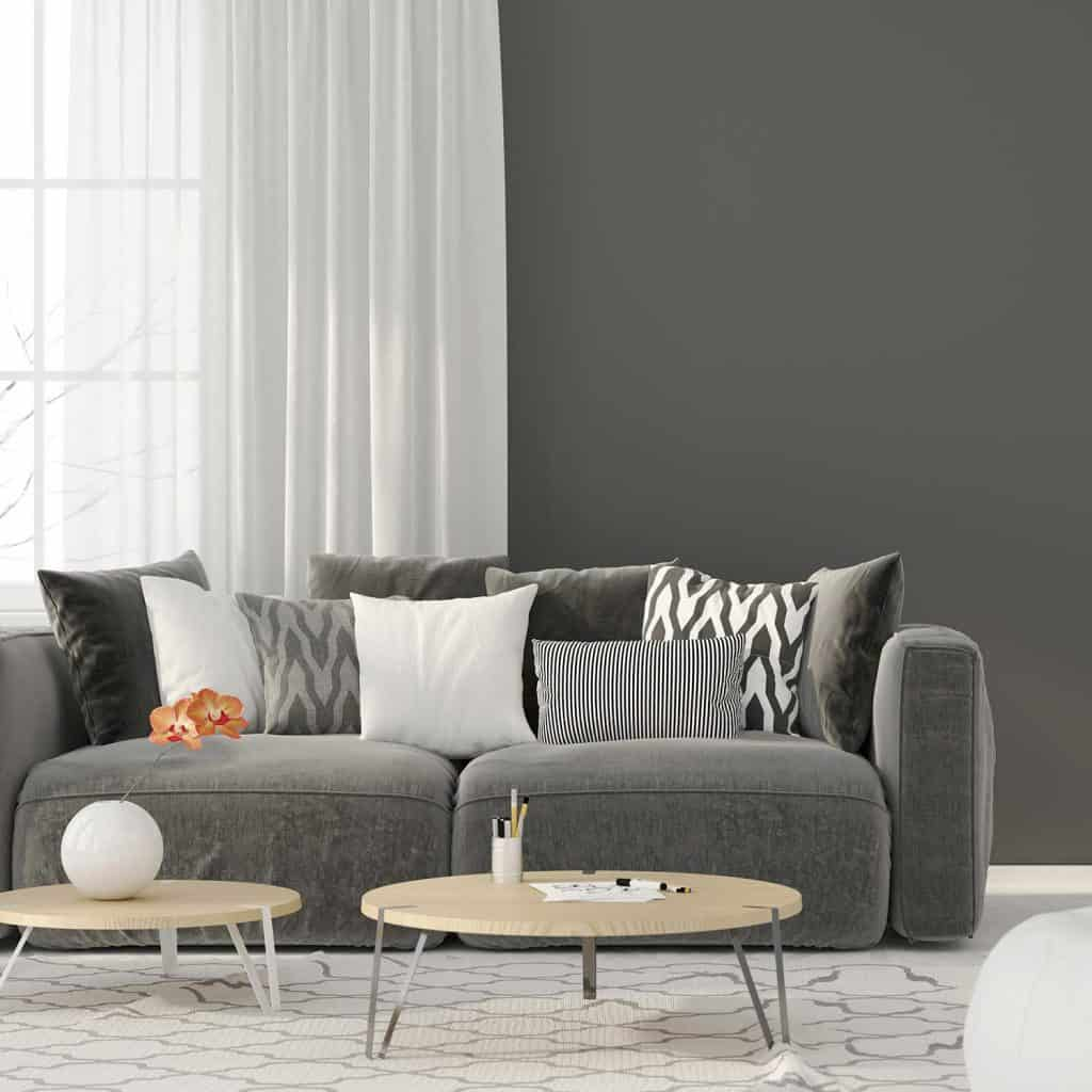 Modern interior of the living room with a grey sofa