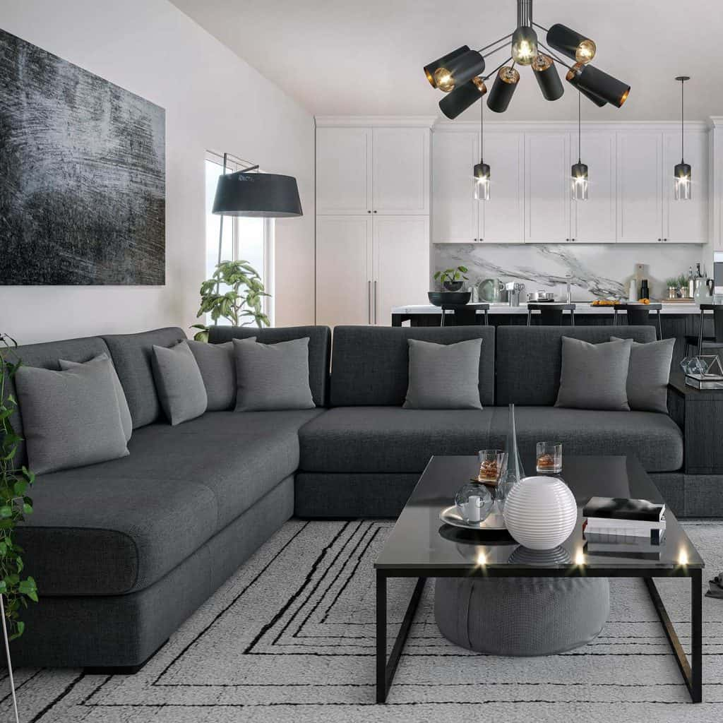Modern living room interior with grey corner sofa, throw pillows, abstract art decor on wall and glass top coffee table