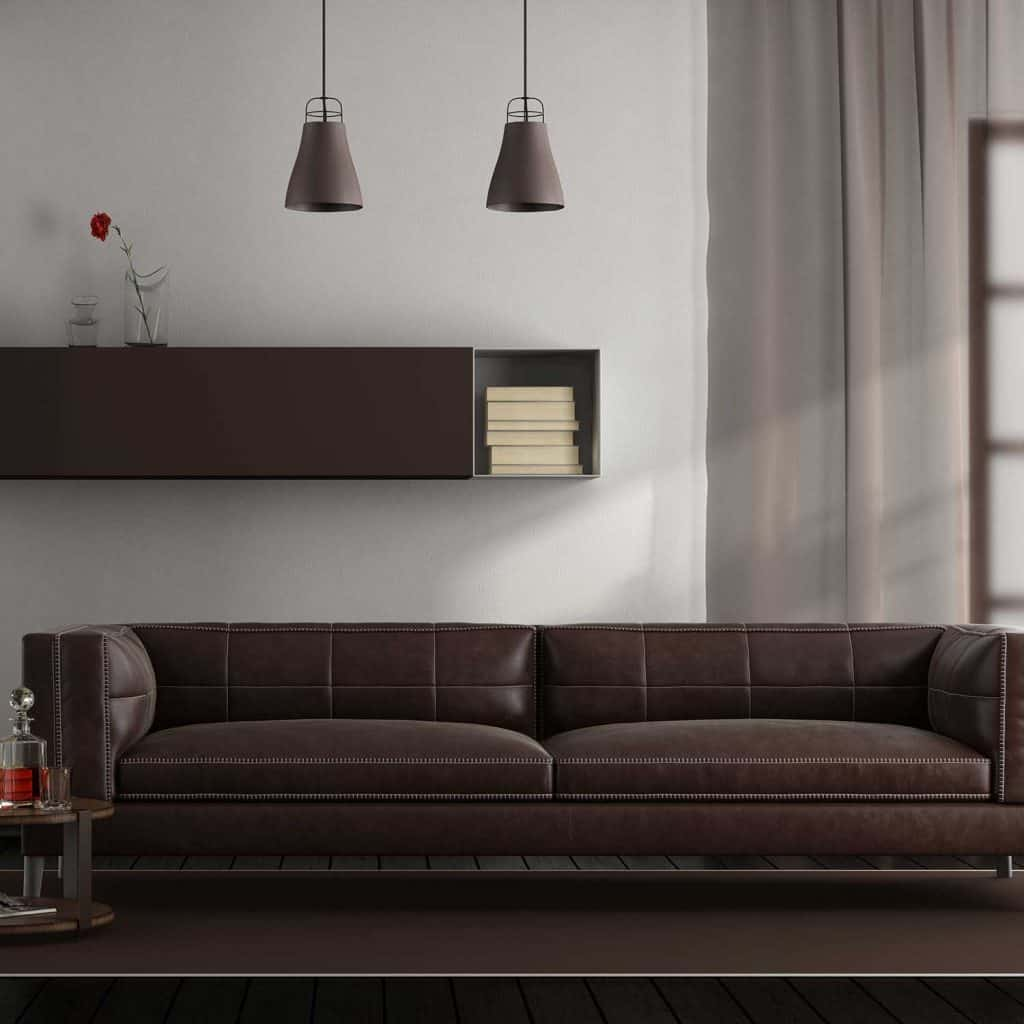 Modern living room with brown leather sofa, carpet and hardwood floor