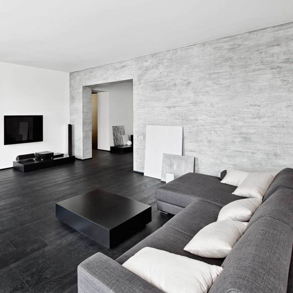 Modern minimalism style living room interior gray sofa, white throw pillows and hardwood floor