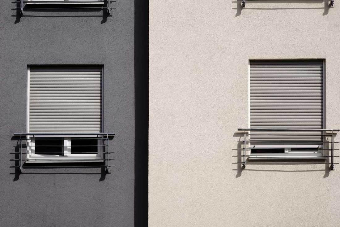 Modern residential house windows / The modern facade of a modern residential building with windows and blinds.