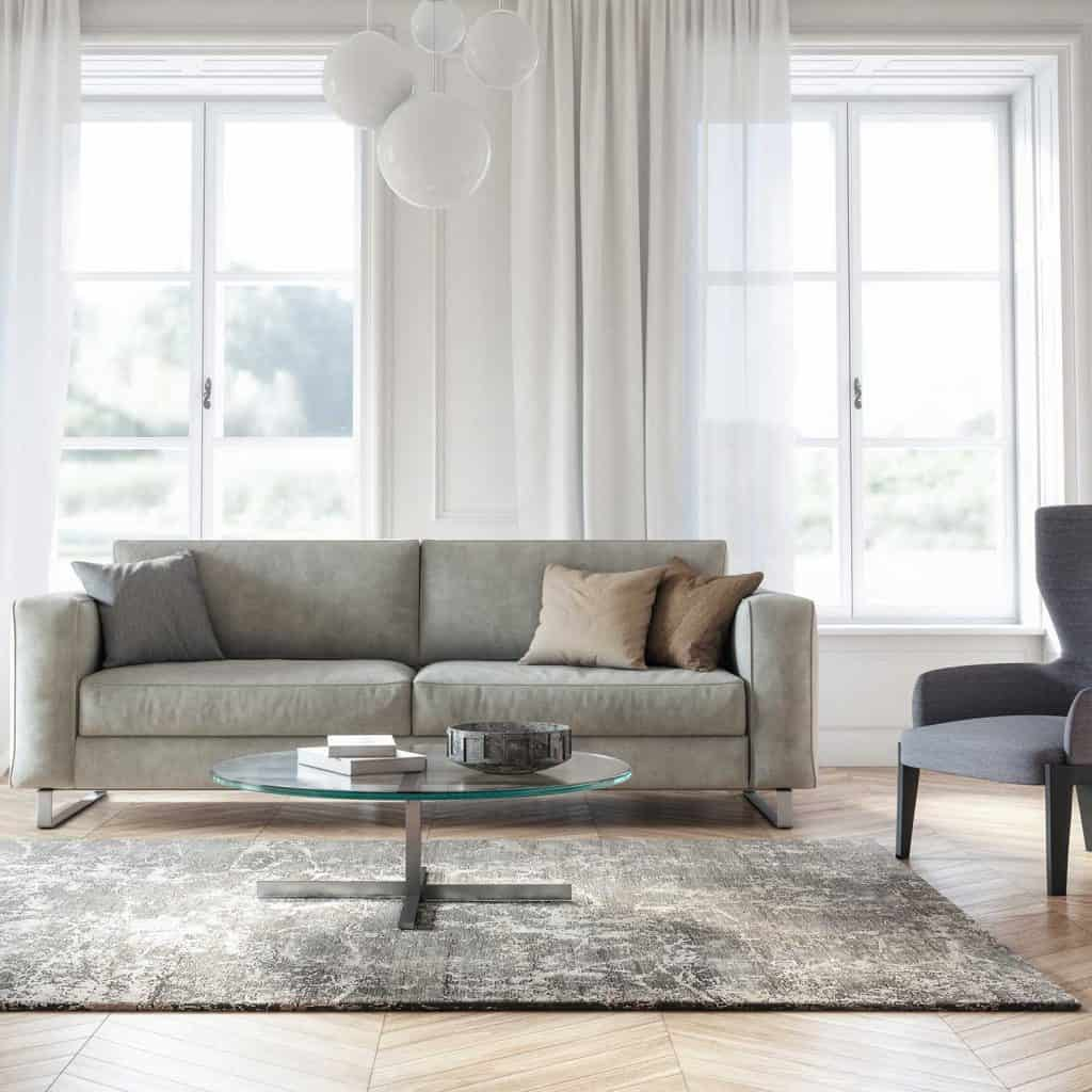 Modern scandinavian interior design living room with gray couch and white curtains