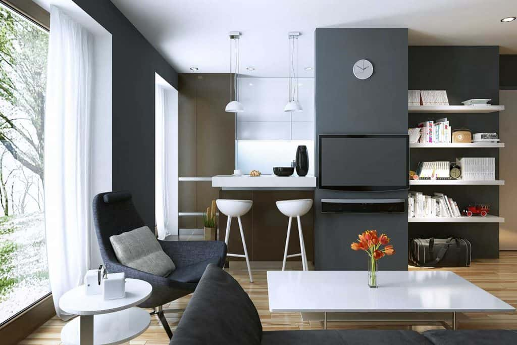 Modern style living room with dark gray walls, sofa, chair, white table and parquet floor