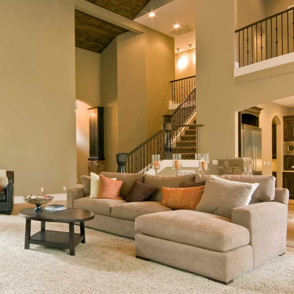 Panorama view of luxury home living room with beige sofa