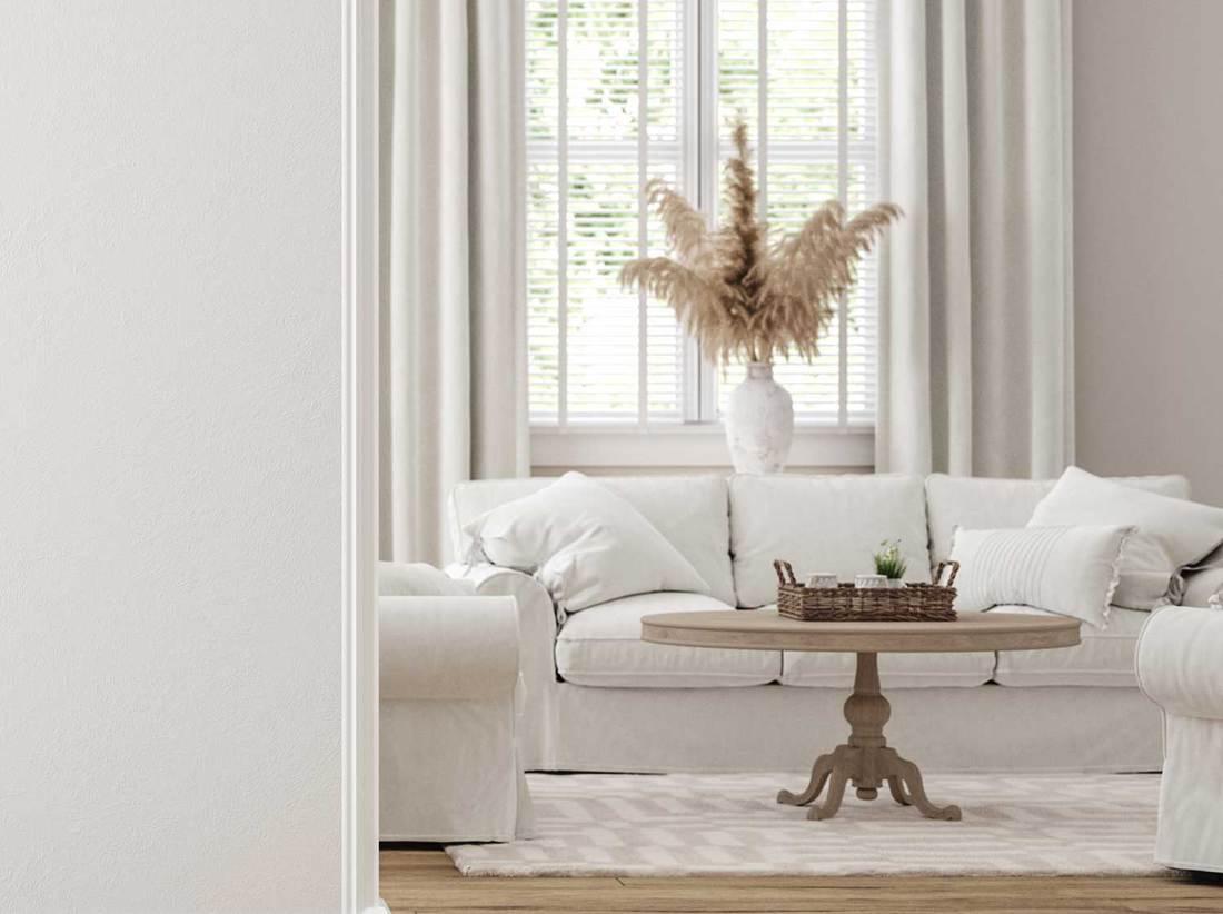 Scandinavian farmhouse living room interior with white sofa and hardwood floor