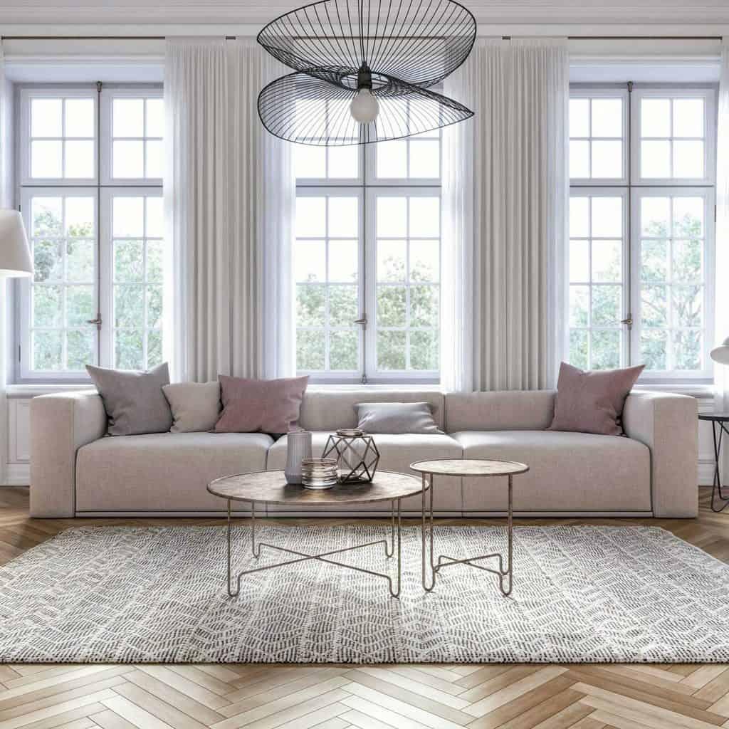 Scandinavian interior design living room with carpet, parquet floor, sofa and throw pillows