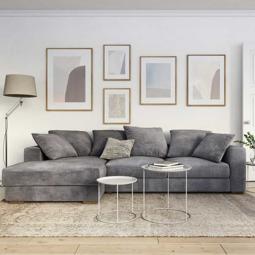Scandinavian interior design living room with grey corner sofa, lamp, coffee table and framed wall art decors