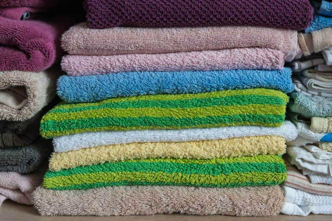Stack of towels in the closet in bathroom