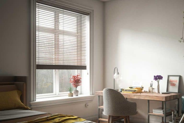 Window with blinds in bedroom interior with office table and chair, What Are The Best Blinds For Blocking Out The Light?