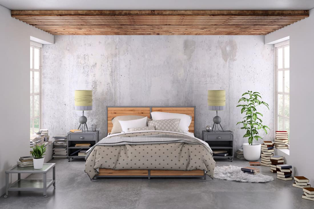 A gray bedroom with a beige colored bed and a trellis like decorative ceiling
