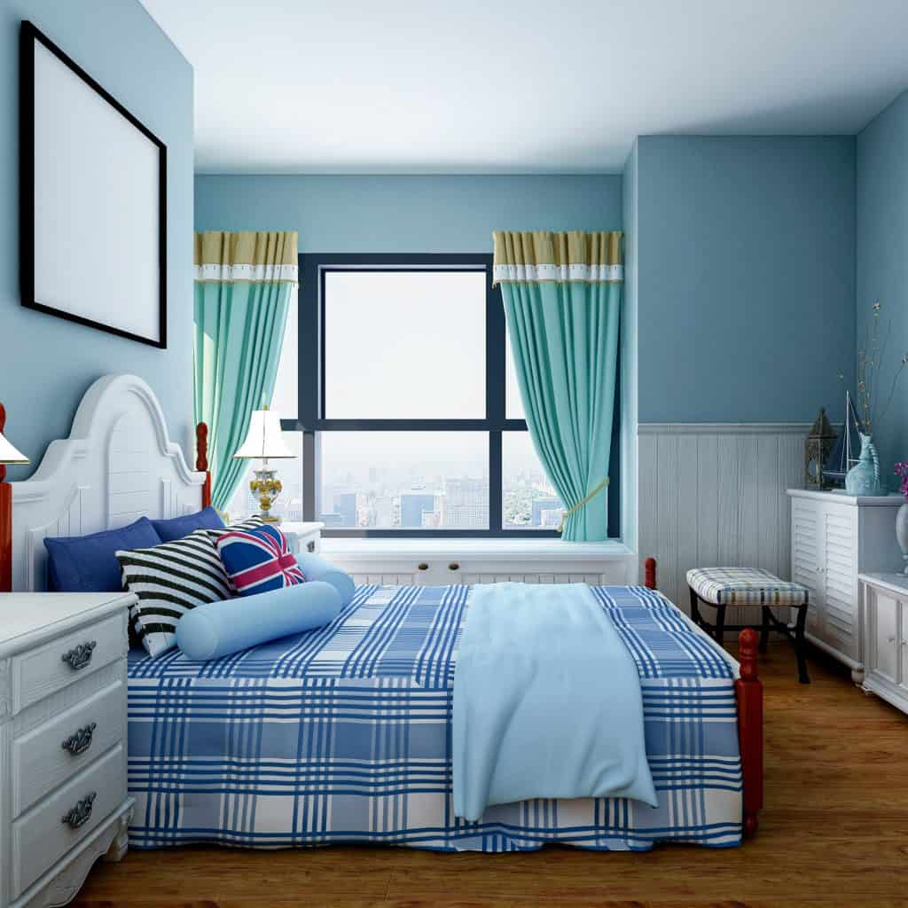 A blue themed bedroom with a blue bed and blue colored walls
