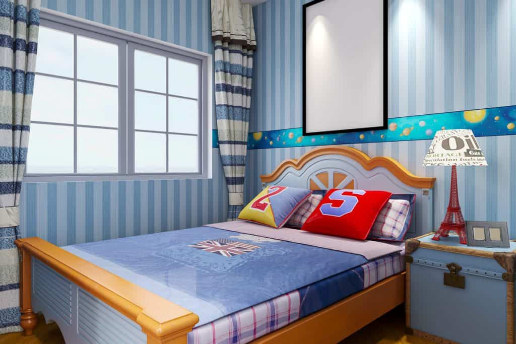 A blue themed bedroom with a blue foam and windows