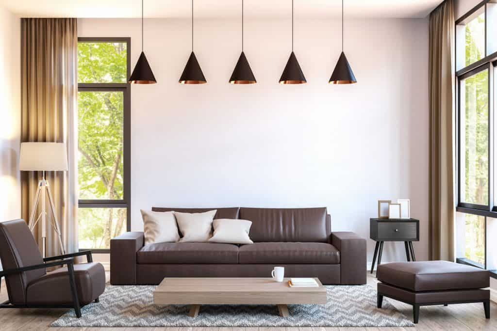 A brown living room furniture set with five brown colored hanging lamps