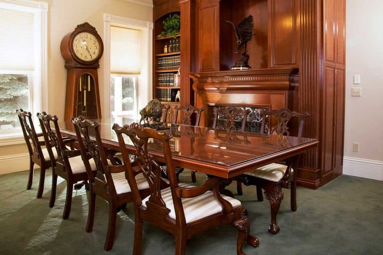 A formal dining room with Grandfather Clock in an antique Victorian style home.