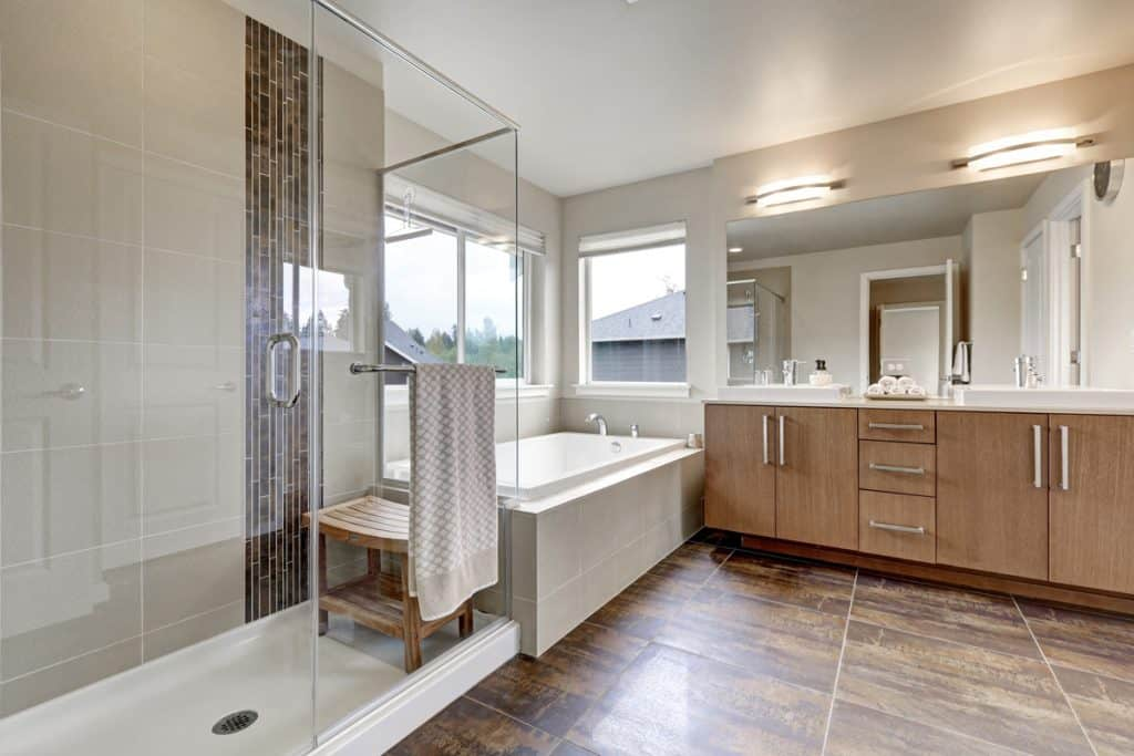 A modern bathroom with a walk-in tub and a white countertop