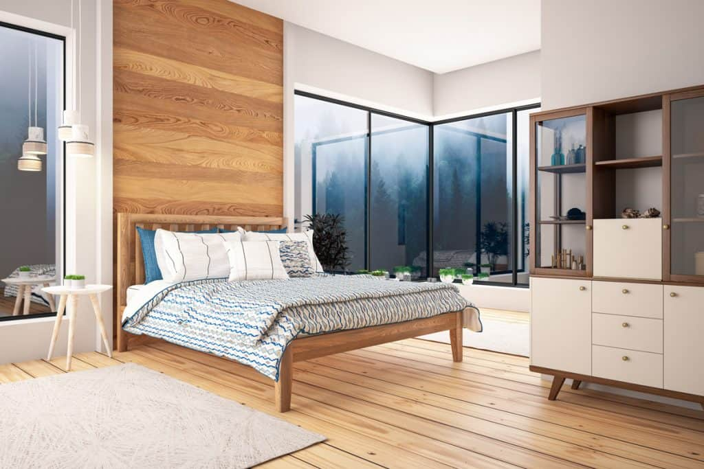 A modern bedroom with a wooden paneled headboard