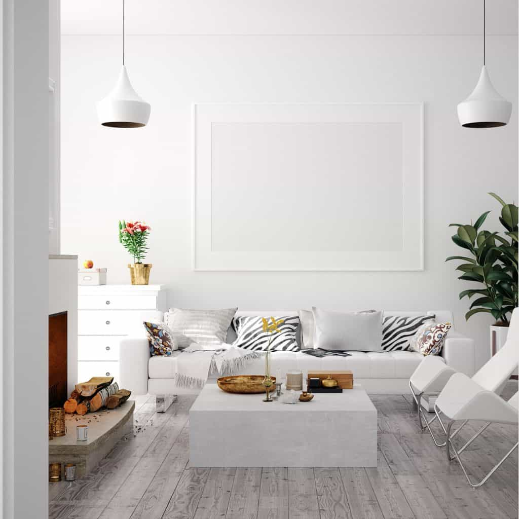 A modern living room with a white wall and a gray flooring