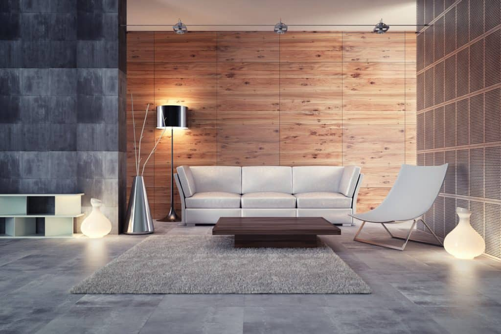 A modern living room with wooden paneling install on the walls
