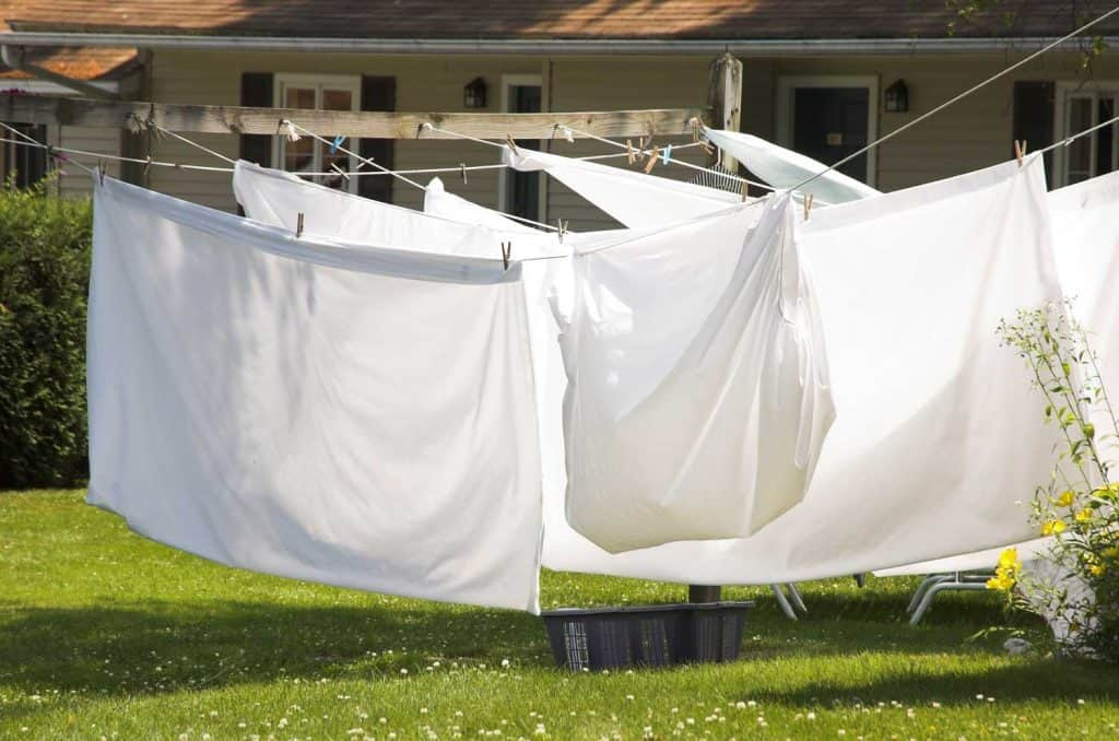 Air drying bed sheets under a sunny afternoon