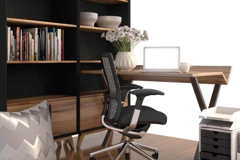 An office chair with a wooden desk and a divider on the side, How To Reupholster An Office Chair [6 Easy Steps]