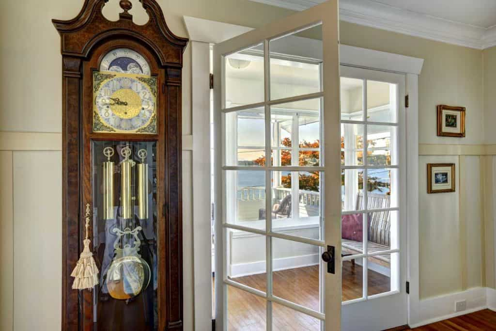 Antique carved wood grandfather clock in living room