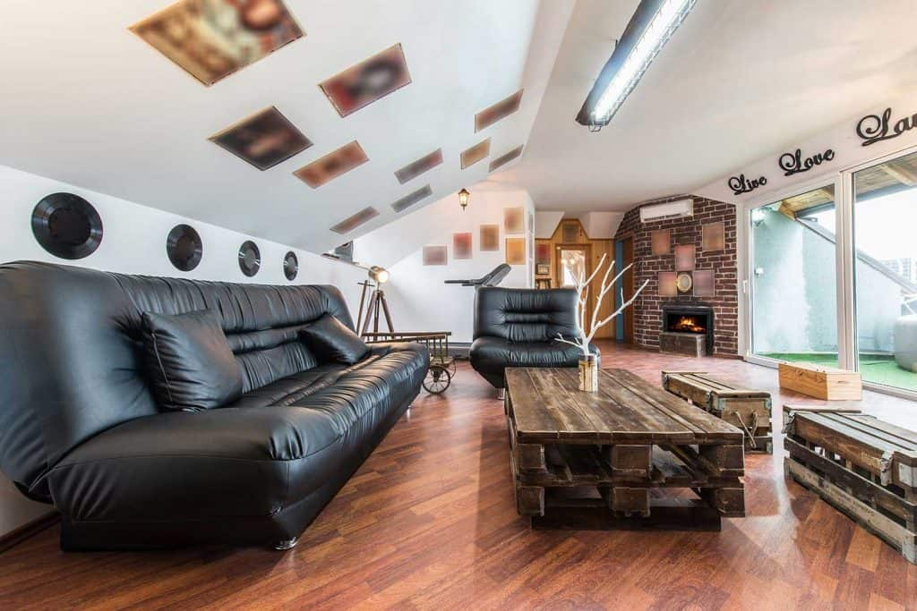 Black leather sofa in loft apartment