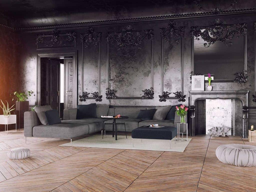 Black style luxury interior with gray sofa, pouf and throw pillows