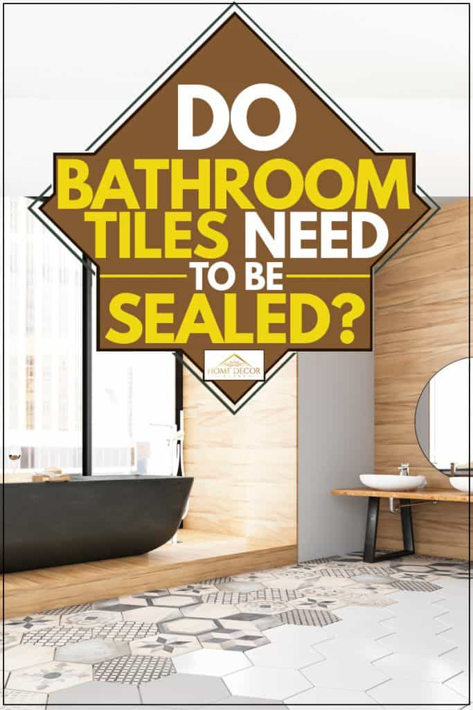 Modern bathroom installed with a huge windows and hexagonal patterned tiles and a black colored bathtub, Do Bathroom Tiles Need To Be Sealed?
