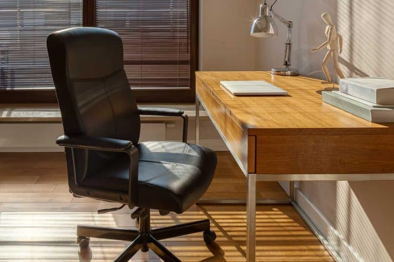 Home office with big window, black office chair, wooden desk and floor, 10 Best Office Chair Brands for your home office