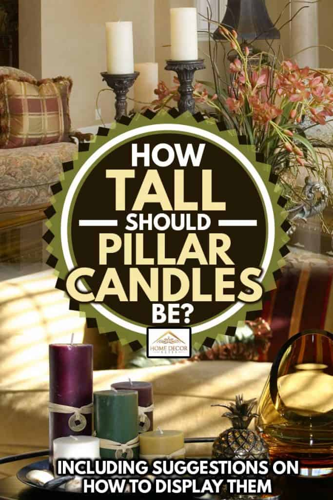 A pillar candle display and accessories catch the morning light. Colorful throw pillows on a golden sofa compliment the accessory colors in a soft focus background, How Tall Should Pillar Candles Be? [Inc. Suggestions on How to Display Them]