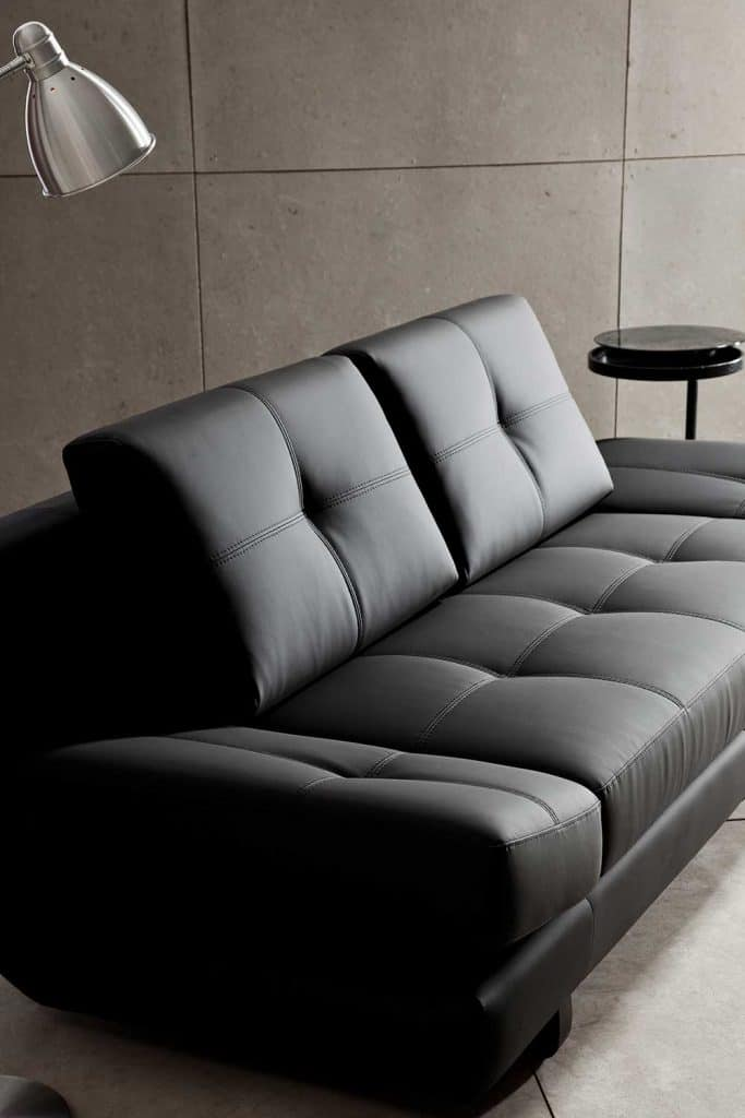 Modern black leather sofa in a living room