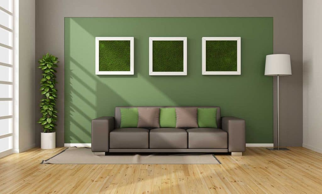 Modern living room with vertical grass in frame on wall