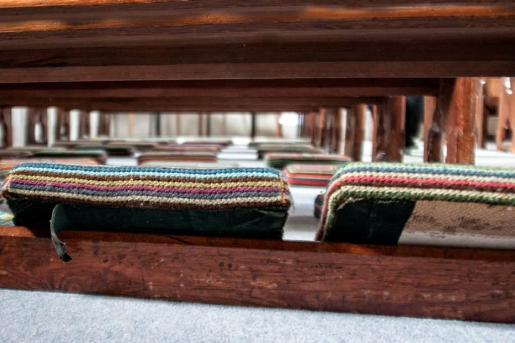 An old brightly colored embroidered church kneelers