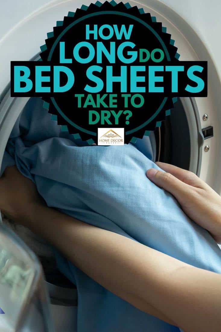 Open door in washing machine with blue bed sheets inside, How long do bed sheets take to dry