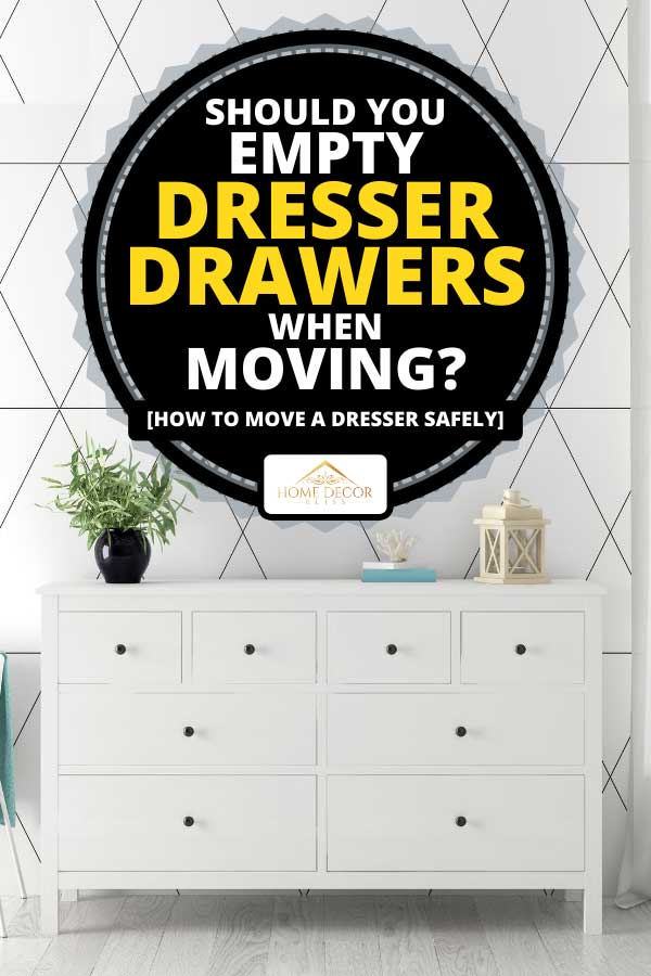 Dresser drawer in a white interior room, Should You Empty Dresser Drawers When Moving? [How to move a dresser safely]