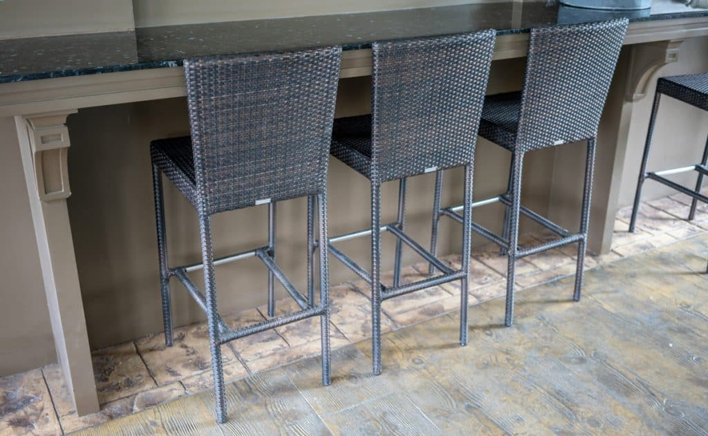 Three metal bar stools on a kitchen