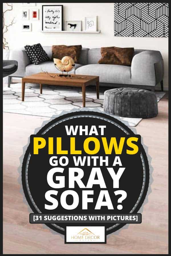 Modern living room with gray couch and accent chair with wooden flooring, What Pillows Go With a Gray Sofa? [31 Suggestions with Pictures]