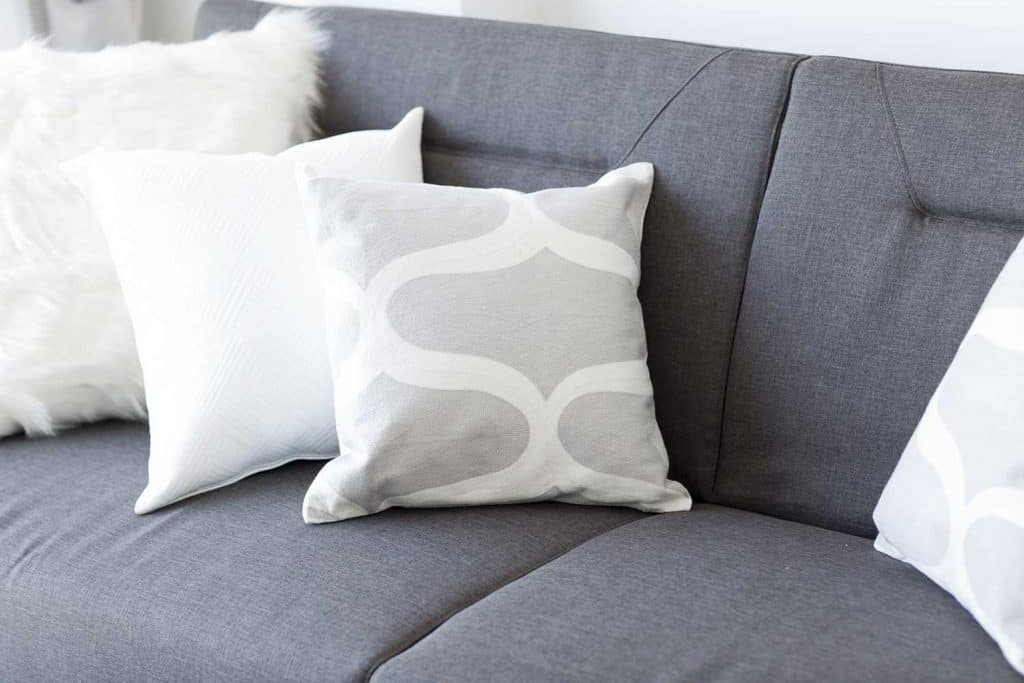 White soft cushion on sofa in a room