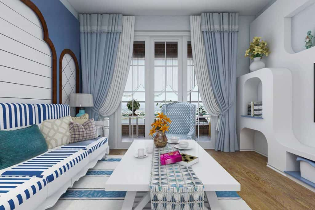 a spacious living room design in a blue Mediterranean-style house with sofas, coffee tables, decorative paintings,