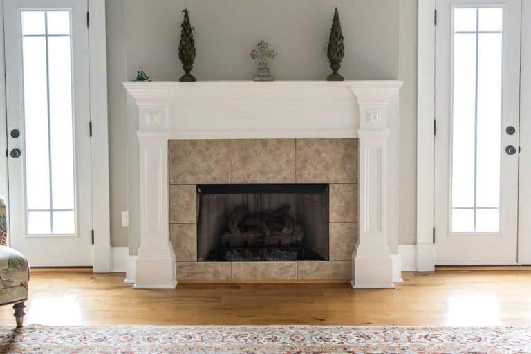 A bright and airy neutral beige living room with tiled fireplace, Should A Fireplace Mantel Be Wider Than The Fireplace?