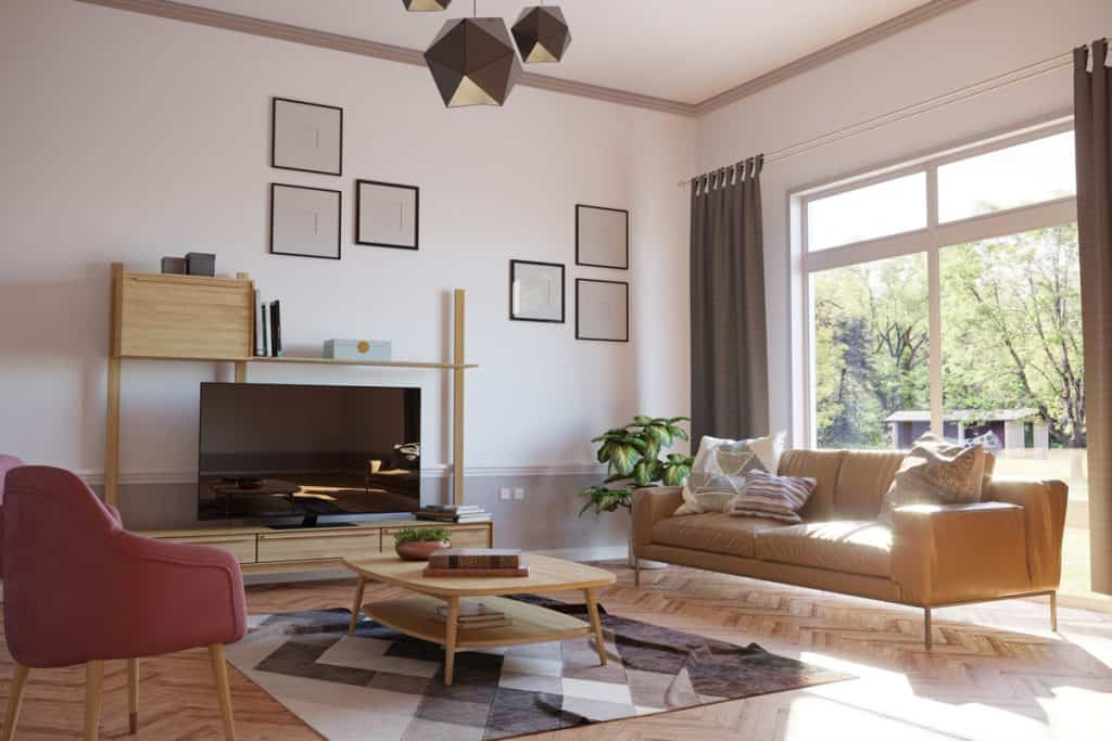A classic living room with brown furniture and a brown flooring