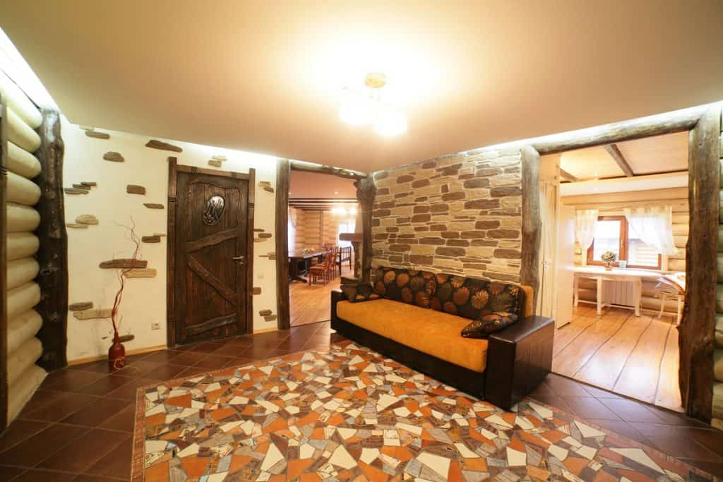 A classic style living area with decorative patterned walls incorporated with stone tiles on the floor