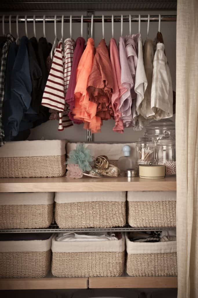 A dresser with organized containers for shirts and pants, and a section for hanged dresses