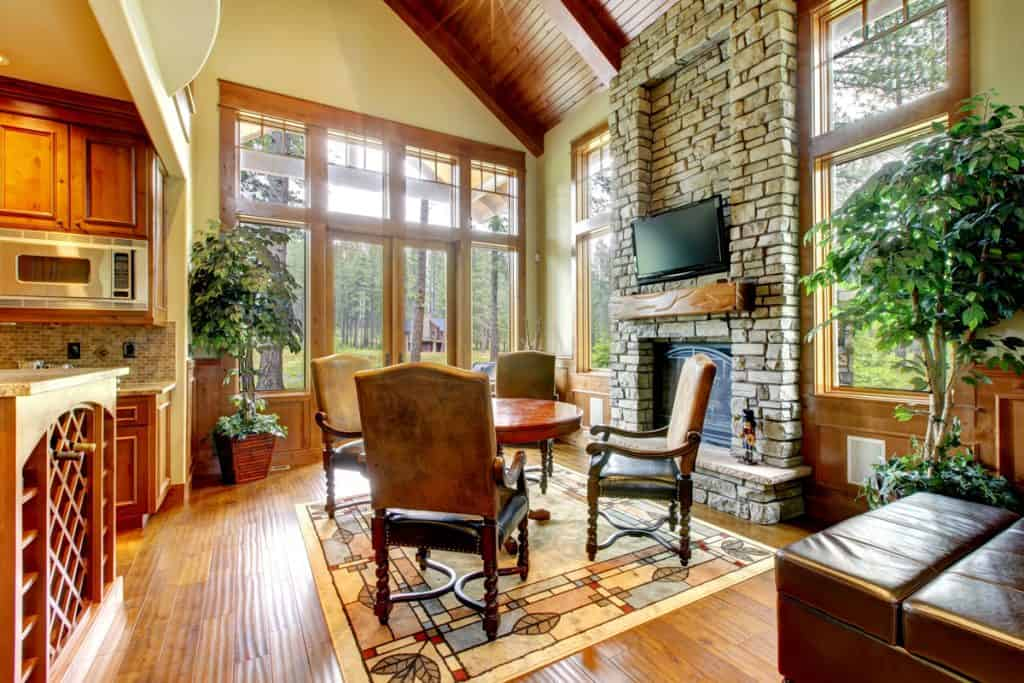 A faux decorated fireplace incorporated with and overall rustic themed house and furnitures
