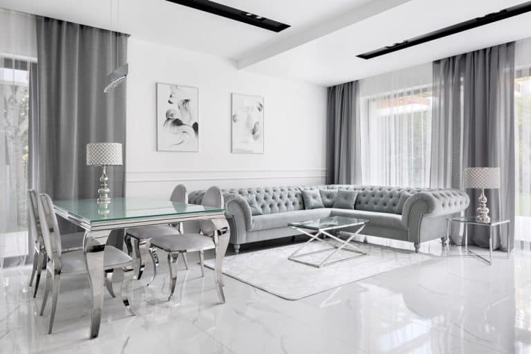 A living room inspired by the shades and tints of gray ranging from the furnitures to the dining table and curtains, 27 Gray And Brown Living Room Ideas