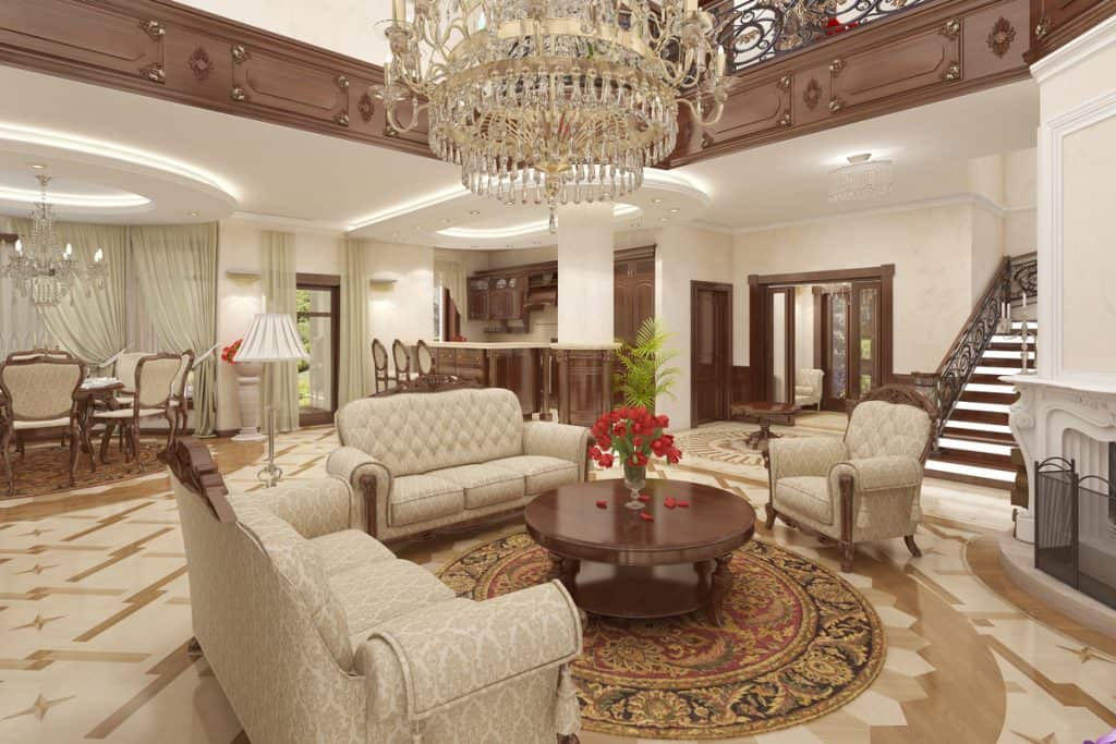 A luxurious mansion consolidated with the colored brown in all of the doors, chairs, and hallways