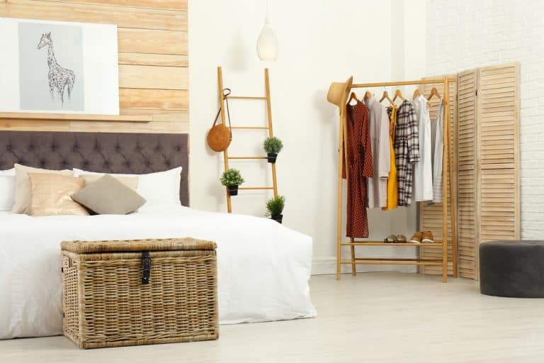 A modern Scandinavian themed bedroom with a dresser on the side, Does a Guest Room Need a Dresser?