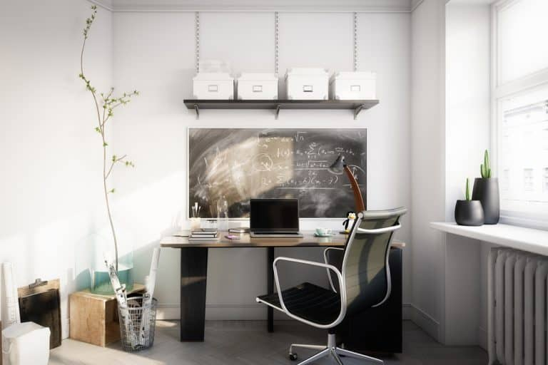 A modern office area with a desk and a laptop placed on top, What Size Desk Should I Get? [Typical sizes Discussed]