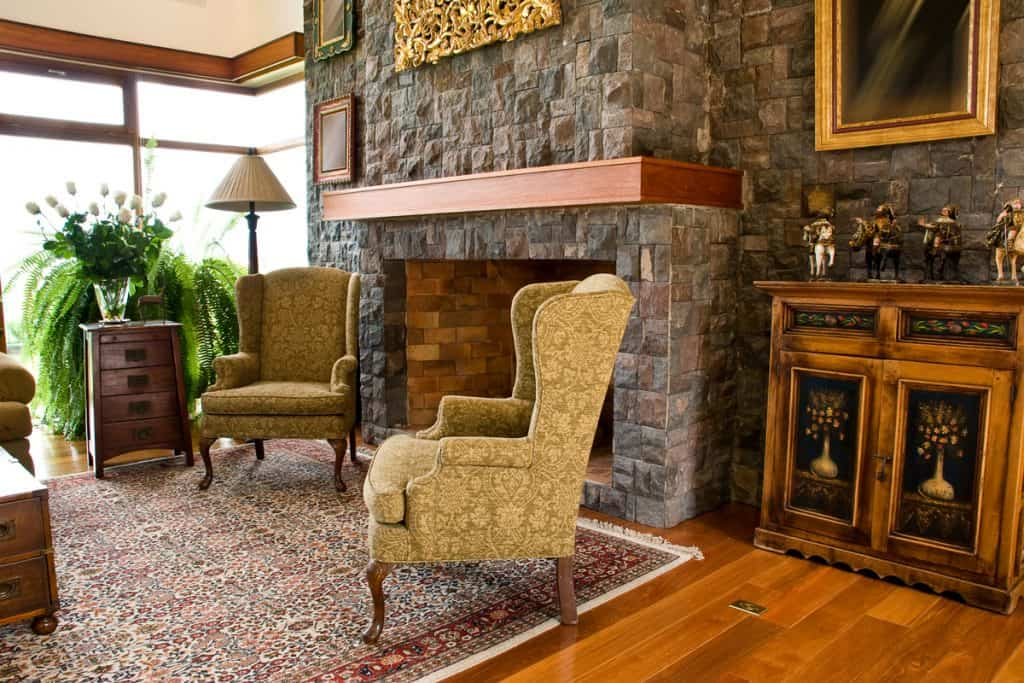 A rustic themed house with matching furnitures and a faux covered fireplace